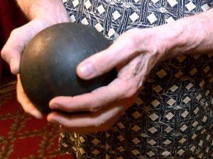 Tony Rivenbark holds a ball that creates the sound of an approaching storm in the thunder run