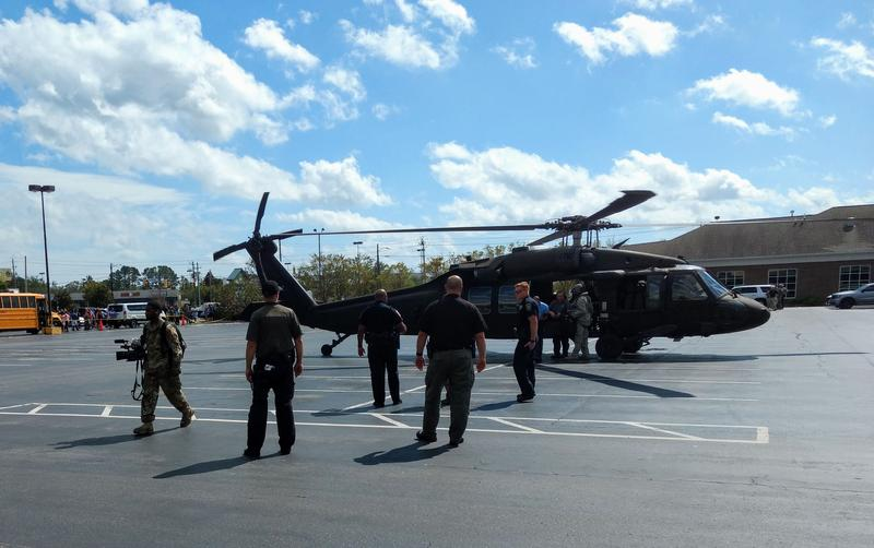 Gov. Cooper and FEMA Chief Long arrived in a military helicopter at a shopping center parking lot in Wilmington Tuesday afternoon.