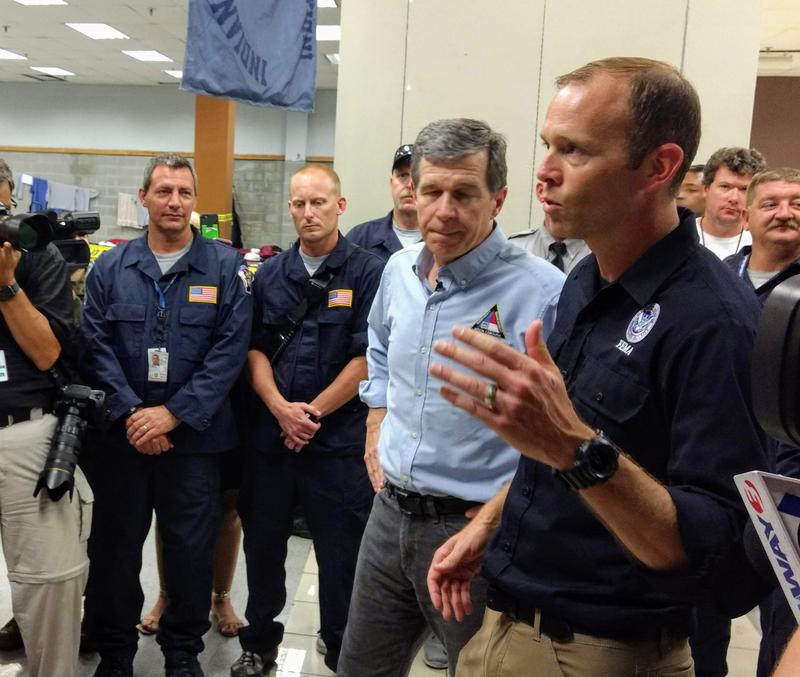 FEMA Chief Brock Long joined Cooper on the tour of Wilmington Tuesday.