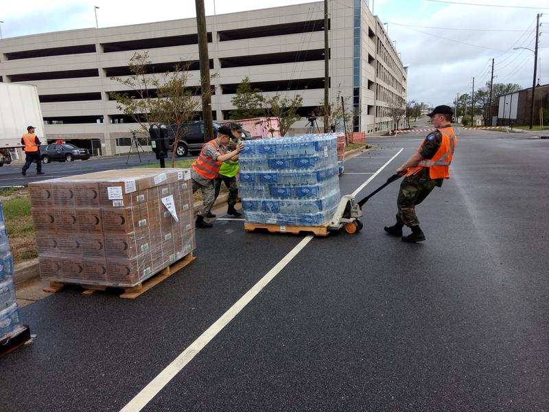 Civil Air Patrol volunteers readied pallets of water and Meals Ready to Eat (MREs) Tuesday morning. The sites also are giving away tarps.