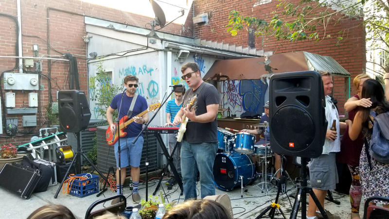 Bottega Art and Wine held a benefit concert Sunday afternoon, while distributing relief supplies.