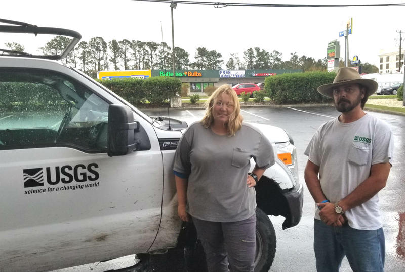 Cortney Crites and Jym Chapman of the USGS are collecting data that will be used by the National Weather Service to develop flood forecasts, and by the Federal Emergency Management Agency.