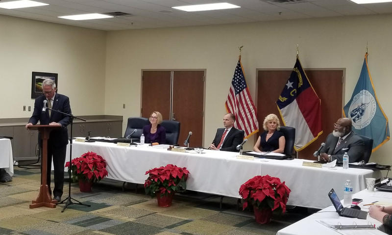 (L to R) County Commissioners Rob Zapple, Patricia Kusek, Woody White, Julia Olson-Boseman and Jonathan Barfield, Jr at Monday's meeting.