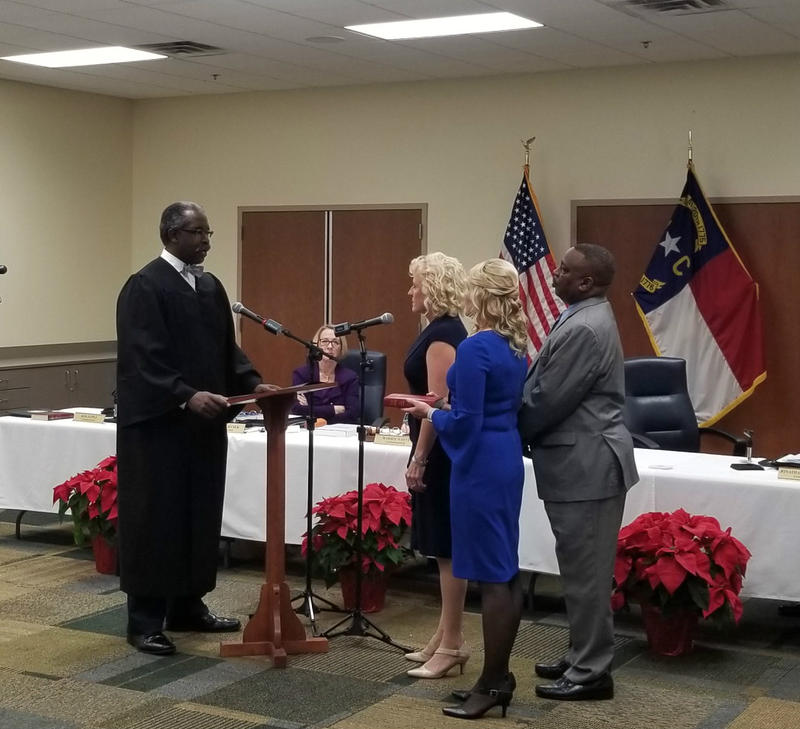 Julia Olson-Boseman is sworn in as a county commissioner Monday.
