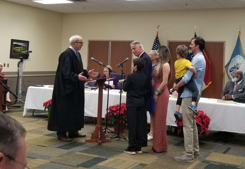 Rob Zapple (center) is sworn in as county commissioner as his family looks on.