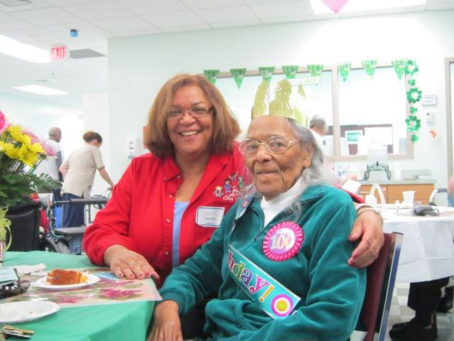 Annette Murphy embraces her mother Julia Devane while celebrating Devane's 100th birthday at the Elderhaus PACE facility in Wilmington.