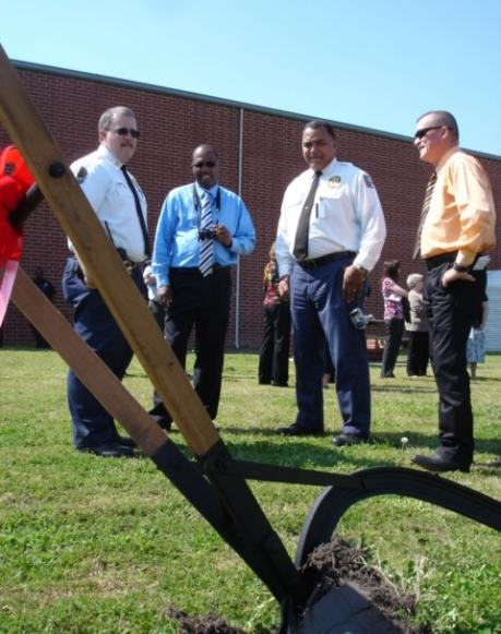 Prison officials look at the plow after the groundbreaking March 14.