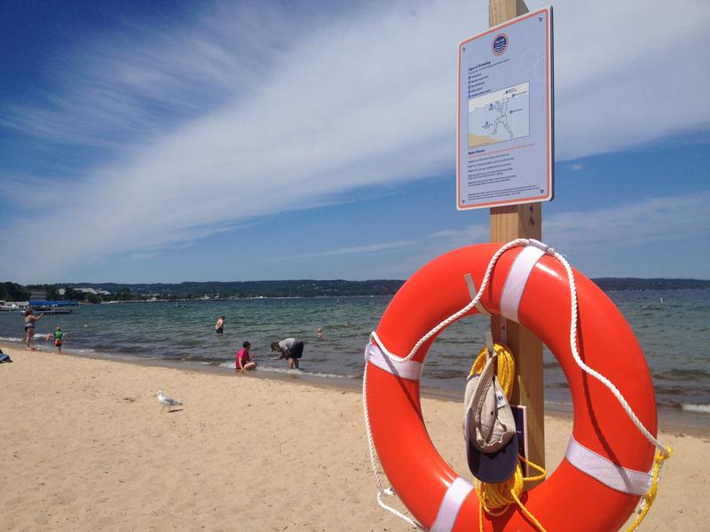 A sign at Bryant Park in Traverse City warns swimmers of drowning danger.
