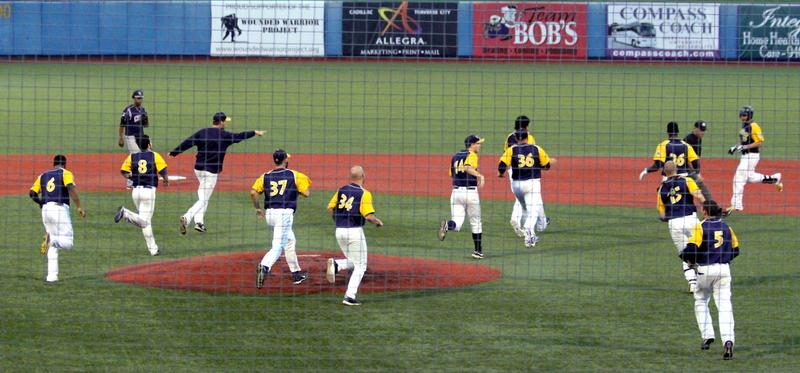 The Traverse City Beach Bums celebrate a victory earlier this season. Tonight, they host Game 1 of the Frontier League Championship Series.