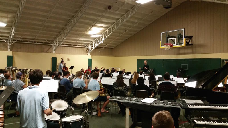 Interlochen Arts Academy Band Director Matt Schlomer leads his band in rehearsal.
