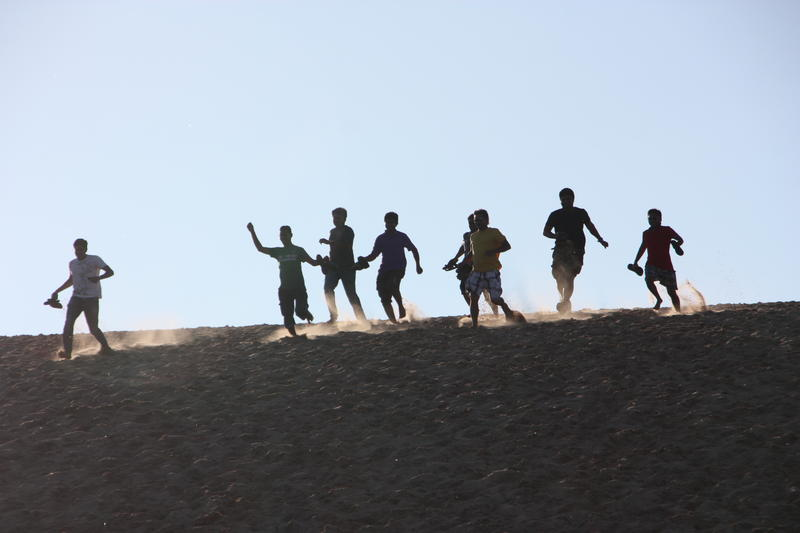 Visitors race down the Dune Climb at Sleeping Bear Dunes National Lakeshore.