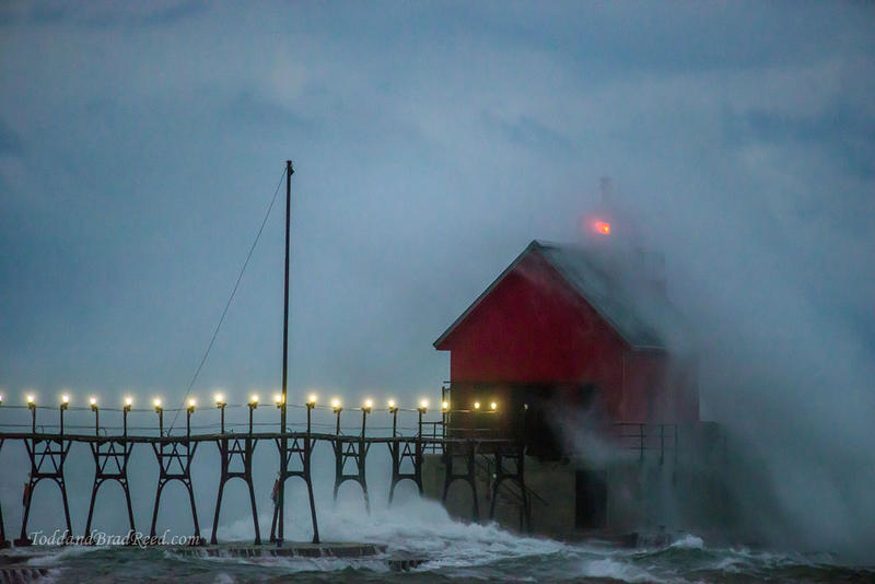 Just after sunset, the pier lights show the way out to the lighthouse at Grand Haven.