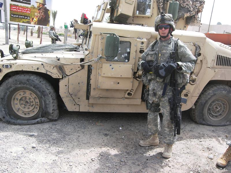 Dunckel next to hit humvee after it had been hit by an IED.