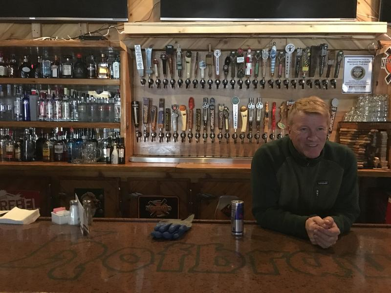Owner Brian McAllister works behind the bar at Hofbrau Steak House and American Grille in Interlochen.