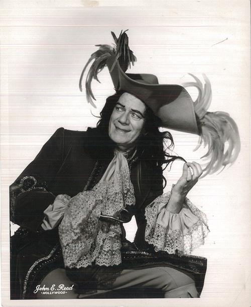 Cyril Ritchard twirls his feathers as Captain Hook in PETER PAN