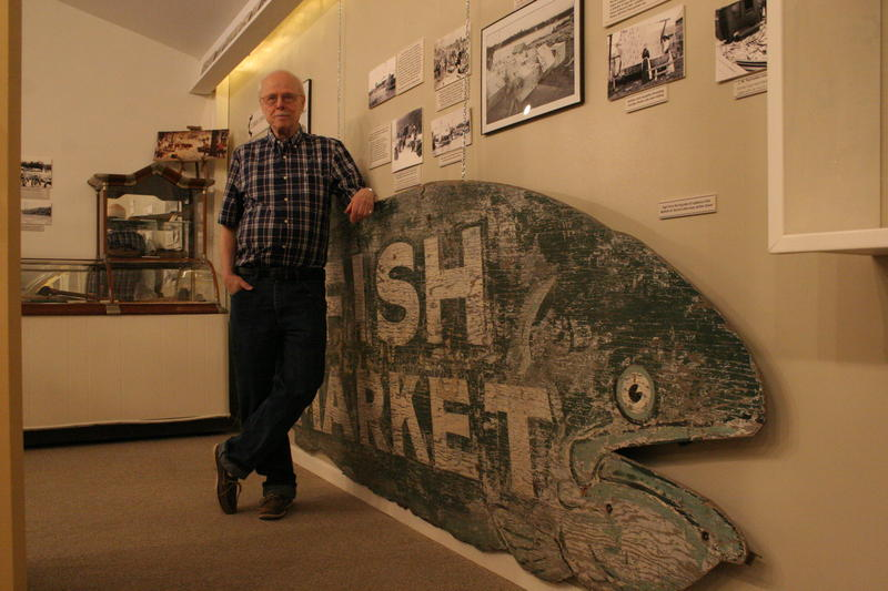 Dave Miles, a curator at the Charlevoix Historical Society, stands by a new fishing industry display. It's part of a new exhibit focusing on the history of business and industry in Charlevoix.