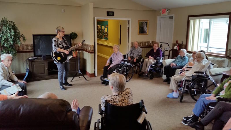 Mary Sue Wilkinson leads a sing-along session at Orchard Creek Supportive Care in Traverse City. Residents who suffer from dementia are still able to connect with the music from years before.