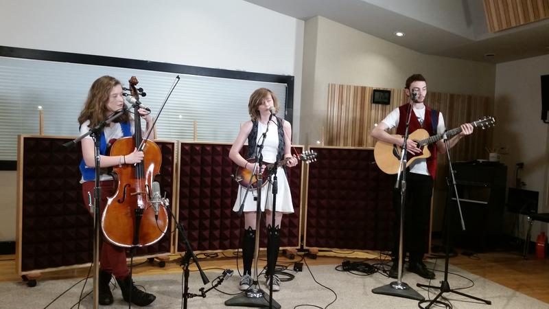 Katie Larson (left), Savannah Buist (center), and Michael Dause (right), of The Accidentals perform 'Sixth Street'. The band released a new EP, 'Parking Lot' on June 1st.