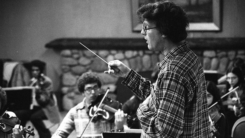 David Holland works with the Academy String Orchestra in this image from the 1978-79 school year.