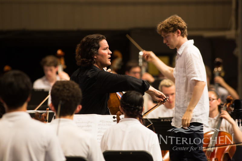 Conductor Joshua Weilerstein conducts soloist Zuill Bailey with the World Youth Symphony Orchestra at Interlochen