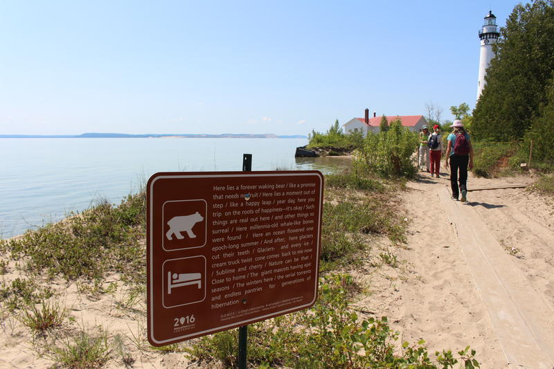 A sign containing Moheb Soliman's poetry located on South Manitou Island.