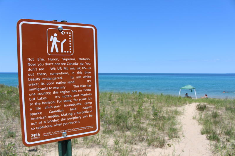 A poem written by Moheb Soliman overlooks Good Harbor Bay Beach in Maple City. Soliman has poems posted in the five Great Lakes National Parks and Lakeshores.