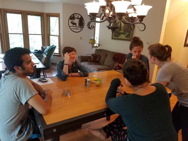 Emilio Rodriguez (left) chats with fellow artists in residence during The MITTEN Lab residency.