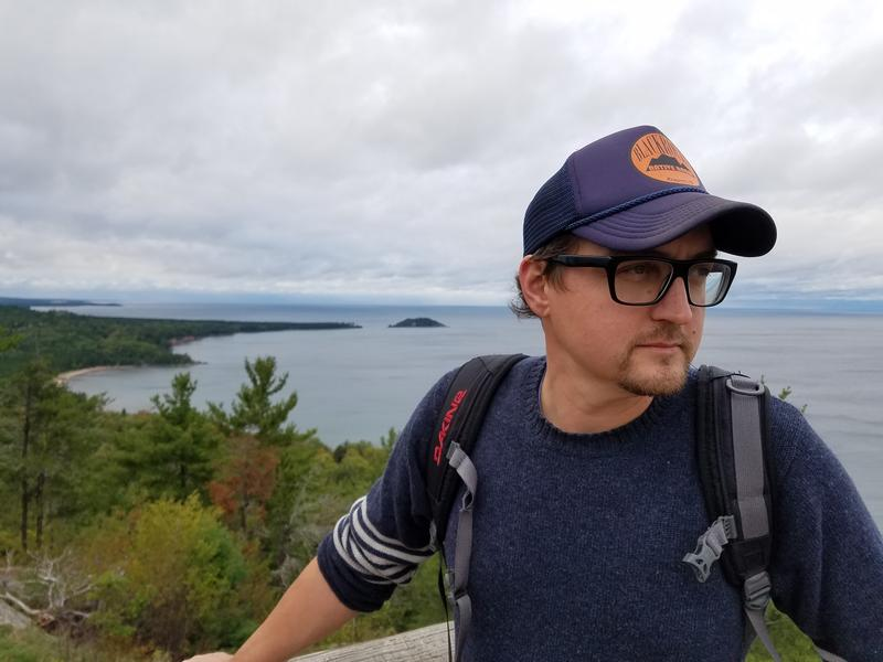 Aaron Peterson stands atop Sugarloaf Mountain, in Marquette. He's launching the Fresh Coast FIlm Festival, in hopes of making more adventure seekers aware of the U.P. and some of the conservation issues facing the Midwest.