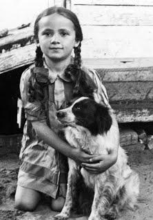 Irene Miller poses with a dog, during her childhood. She'll share her Holocaust survival story tonight at the Dennos Museum Center in Traverse City.