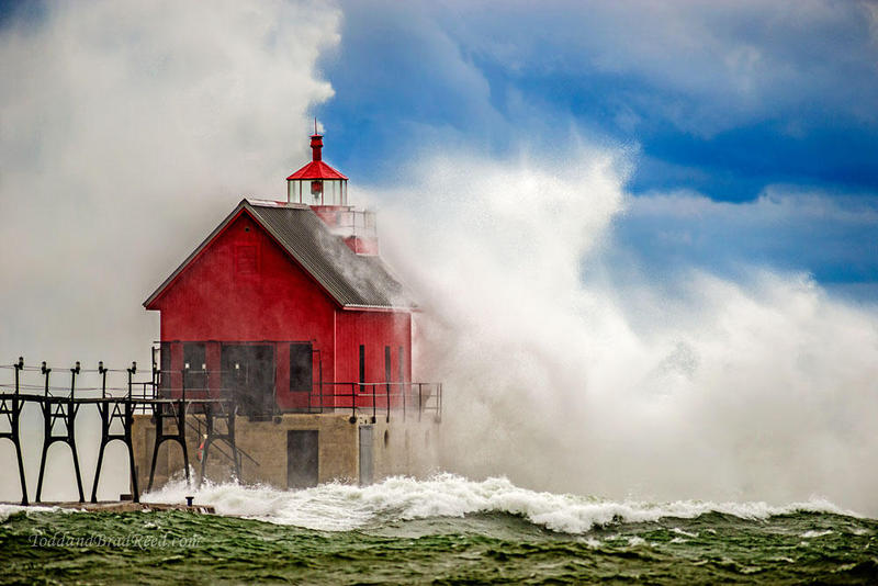 The Grand Haven lighthouse and waves get a good dose of what Todd and Brad Reed call,