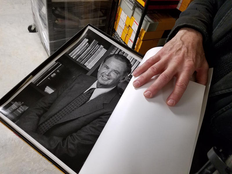 Photographer John Robert Williams shows a portrait he took of Gov. William Milliken. Williams recently donated his film collection to the Traverse Area District Library.