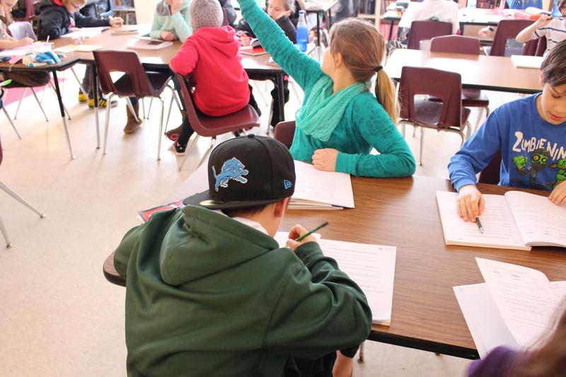 Ben Anderson works on a language arts exercise in Sam Walter's fifth grade class at Blair Elementary School.
