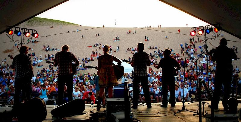 Northern Michigan has a lot of option in terms of summer music festivals and concerts. On July 9, you can listen to a concert while you sit on the Sleeping Bear Dunes.