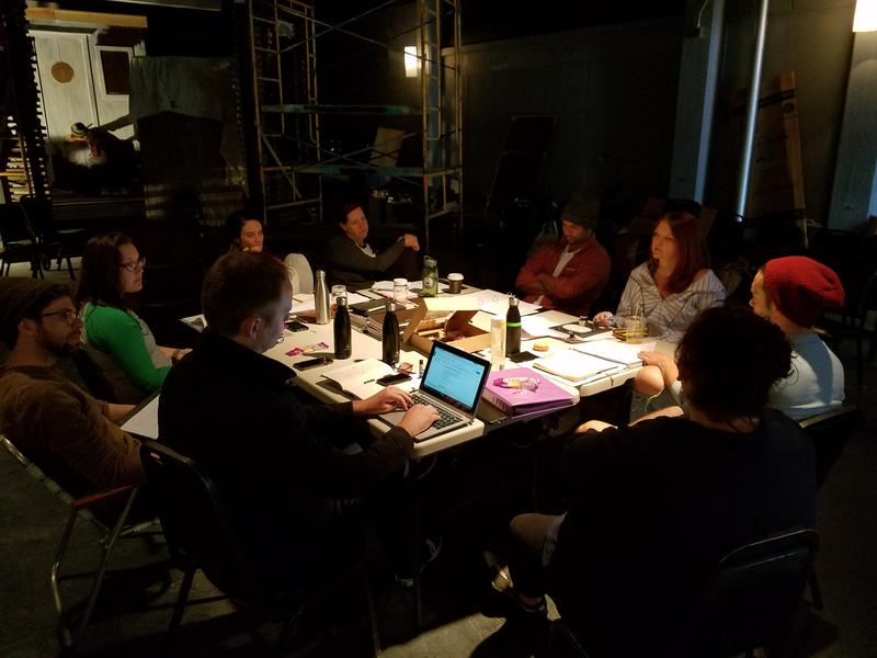 The cast of 'Mr. Burns, A Post-Electric Play' gathers for a rehearsal earlier this week. The show explores what a society might hold onto after an apocalyptic event.
