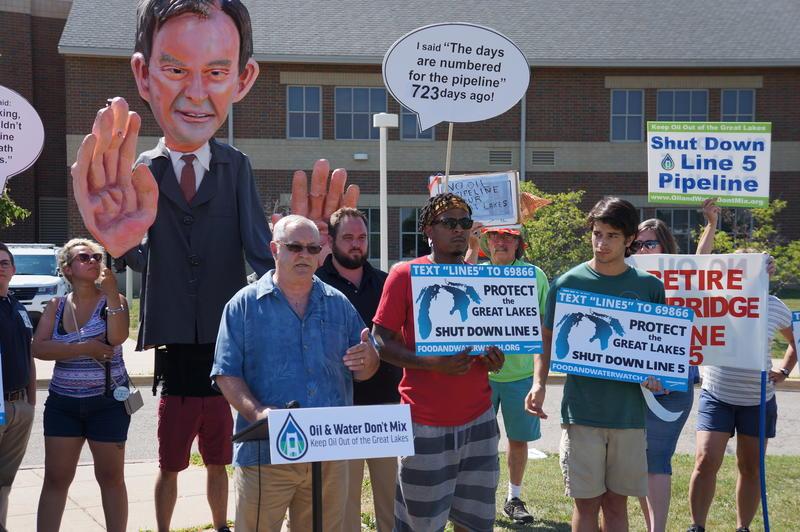 David Holtz protests ahead of meeting on Enbridge's Line 5 pipeline.