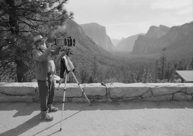 Ansel Adams takes a moment to adjust his camera in Yosemite National Park. An exhibit  featuring some of Adams' most iconic work is hanging at the Crooked Tree Arts Center in Petoskey.