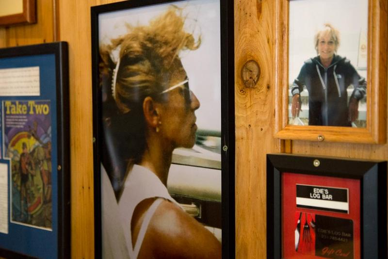 An old photo of Edie Mitchell hangs in the 'No PLace Special Log Bar & Grill.'