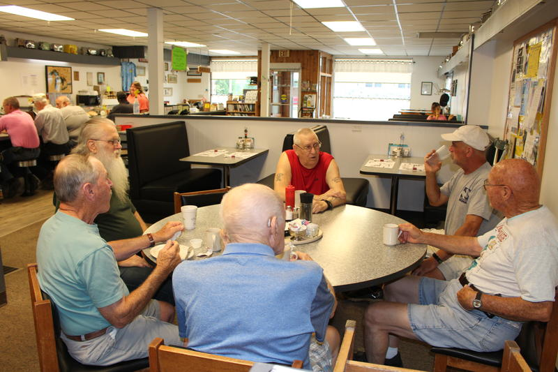 """The Table of Knowledge"" is a group of mostly old-timers who gather every morning at The Front Porch Cafe for a cup of coffee or a bite to eat."
