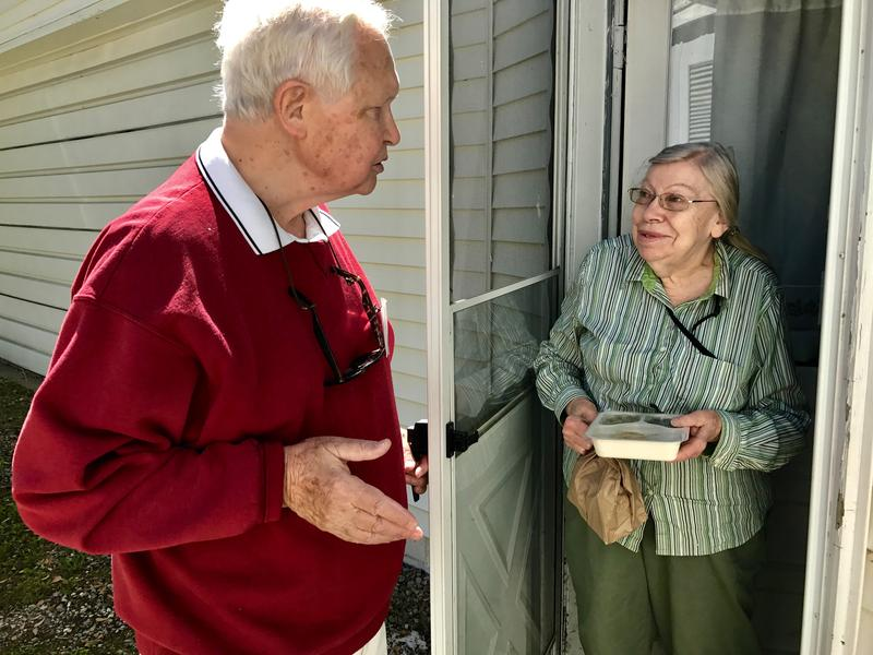 Jack Alexander delivers a meal to Beverly Stevens at her home in Traverse City. Jack has been volunteering for Meals on Wheels for two years.