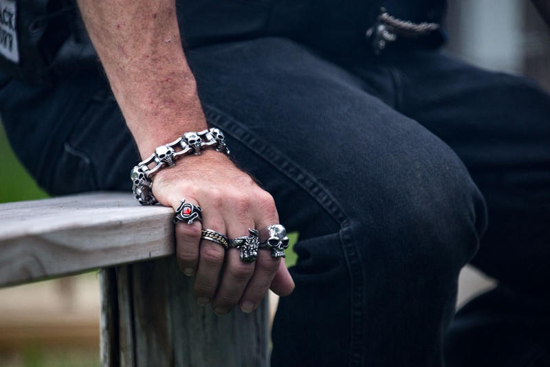 A man shows off his rings at bike night in Rapid City.