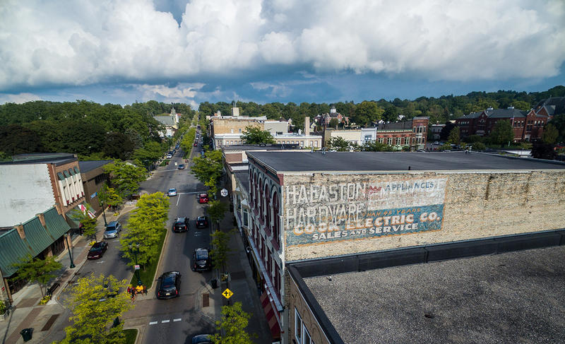 An old mural on the Coburn building in downtown Petoskey was recently repainted by artist Äbby Kent.