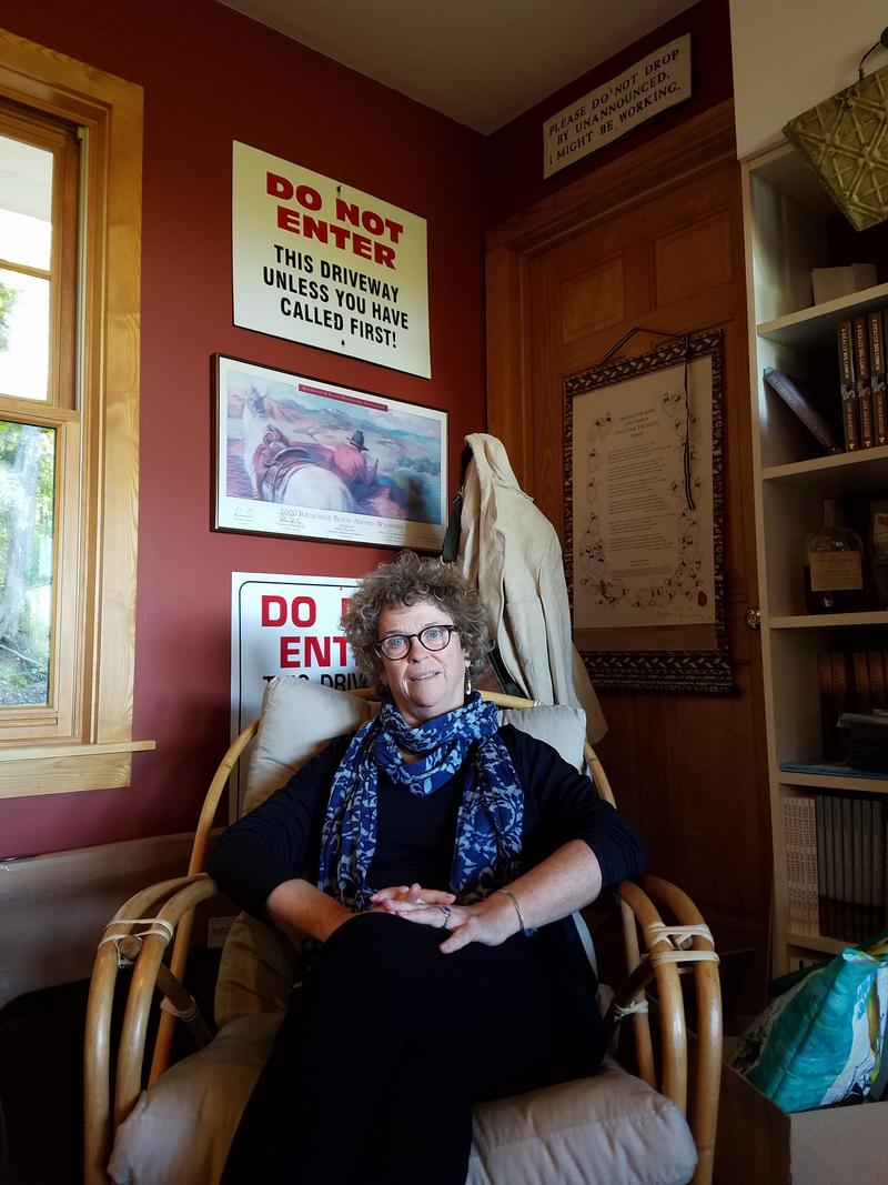 Joyce Harrington Bahle was Jim Harrison's assistant for over 35 years. Here she's pictured sitting in one of Jim's old chairs.