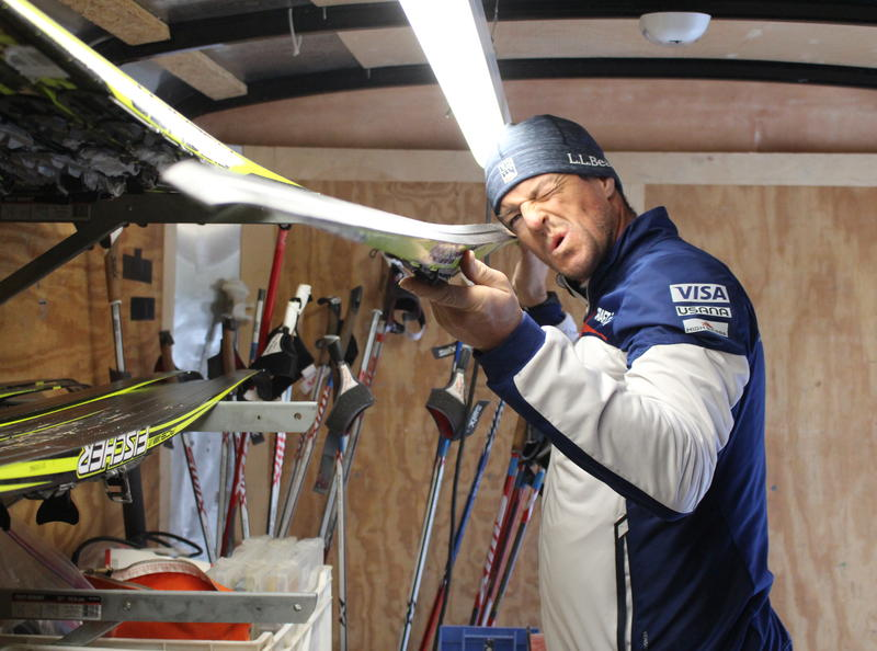 Eli Brown stares down one of his skis in his wax trailer, just off the VASA Trail in Traverse City. Brown will head to South Korea to serve as ski support for Team USA cross-country skiers during the 2018 Winter Olympics.