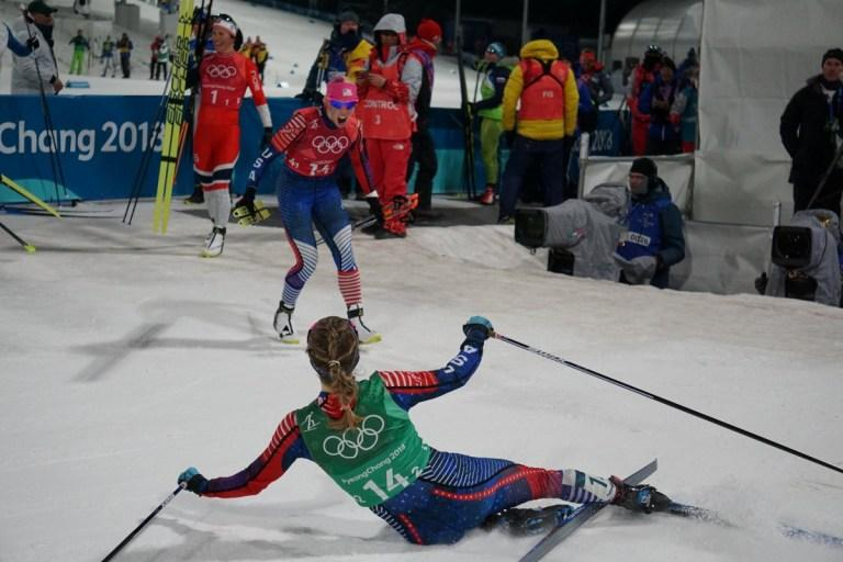 Jessie Diggins (foreground) is greeted by her American teammate Kikkan Randall after she crossed the finish line in the women's freestyle team sprint.