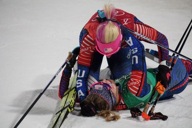 Jessie Diggins is embraced by her teammate Kikkan Randall after winning Team USA's first-ever Olympic gold medal.