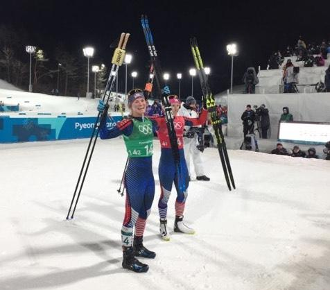 American cross-country skiers Jessie Diggins (left) and Kikkan Randall celebrate after winning the gold medal in the women's freestyle team sprint.