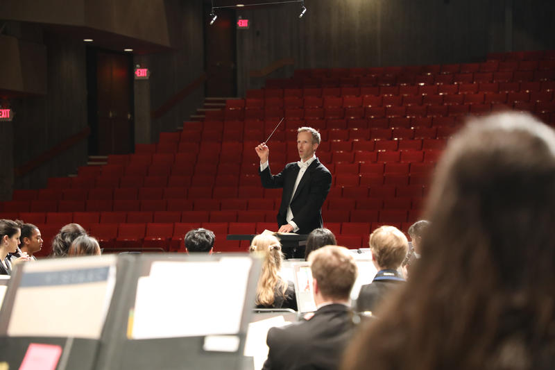 Interlochen Arts Academy Band Director Matthew Schlomer leads students in a recent dress rehearsal.