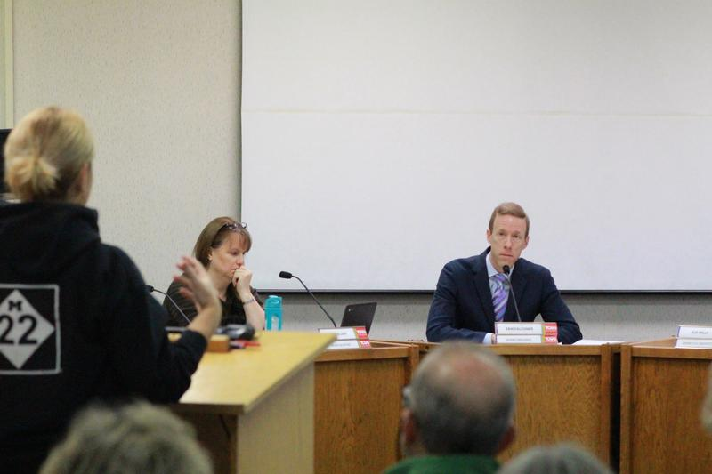 A Traverse City teacher gives public comment in support of TCAPS Superintendent Paul Soma, Saturday. Board members Doris Ellery and Erik Falconer look on.