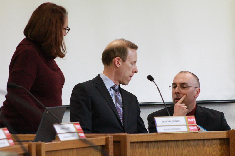 TCAPS Superintendent Paul Soma consults with school board president Erik Falconer before Monday's meeting.