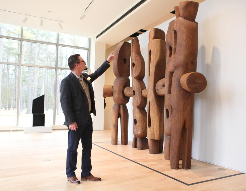 Jason Dake, the education curator at the Dennos Museum points out some art during a recent walk-through of the museum.